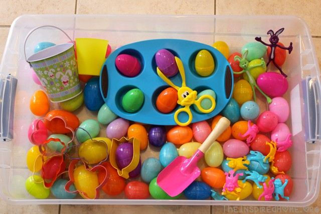TheInspiredHome.org // Easter Sensory Bin using plastic eggs, cookie cutters, a bucket, shovel, muffin tin and more!