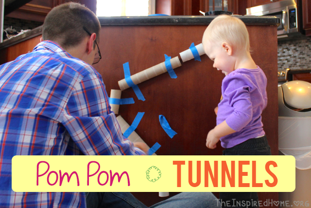 Pom Pom Tunnels are a simple way to occupy your toddler using only 3 items from around the house. From TheInspiredHome.org