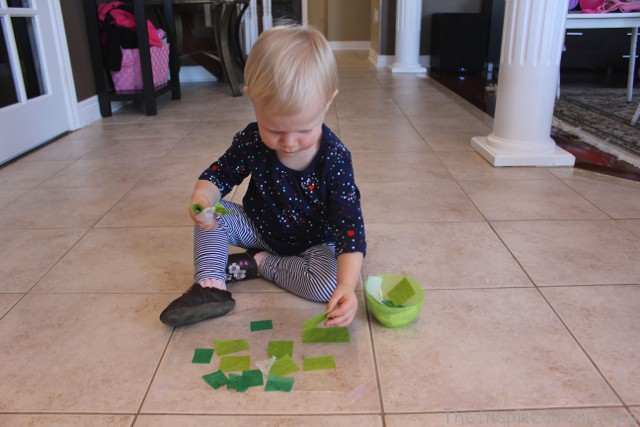 Make shamrocks this St. Patrick's Day using contact paper and tissue paper. The perfect toddler craft! From TheInspiredHome.org