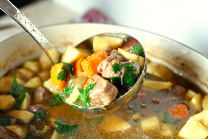 TheInspiredHome.org // Beer Braised Pork Stew Recipe with Apples and Root Vegetables being spooned by a ladle